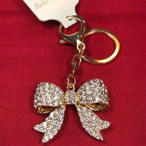 Rhinestone bow purse charm, gold tone